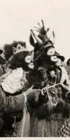 photograph of Zulu King Louis Armstrong meeting the press on Mardi Gras day, 1949