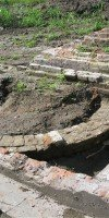 Historic sugarmill cistern base, foundations, and drain after excavation.