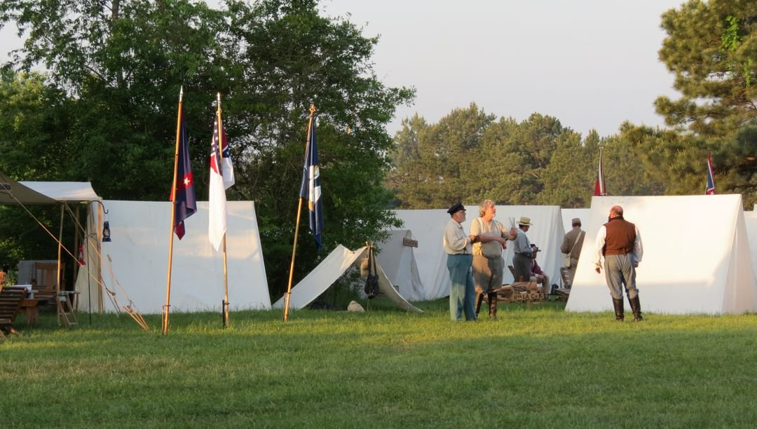 Volunteers in tents during one of the battle reenactments
