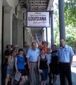 Honda Goldwing Motorcycle Club of Montreal members and Louisiana travel counselors outside the Louisiana Welcome Center on Jackson Square, New Orleans