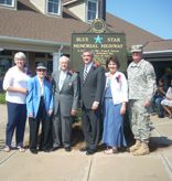 Sherrell Bozeman, president of the Alexandria Garden Club;  Martha McBurney and Mack McBurney, WWII veterans; Lt. Governor Jay Dardenne; Jill Curtis; and Maj. Gen. Glenn Curtis